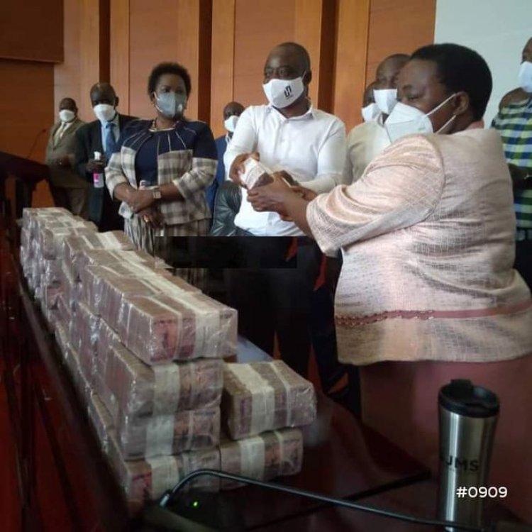 Prime Minister Nabanja receives, banks UGX 530 Million cash pledge from Ham Kiggundu towards COVID-19 response